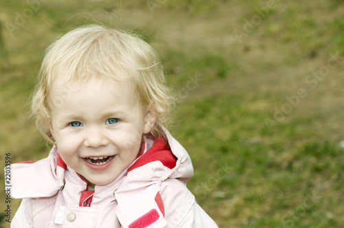 Adorable 2-Years-old Smiling Girl with Beautiful Blue Eyes