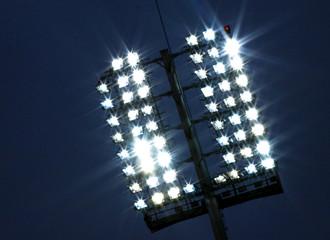 Stadium lights and dark blue sky