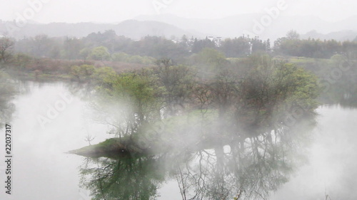 timelapse of fog crossing over river