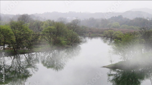 beautiful old village in China, timelapse of fog crossing