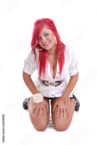 Sexy red haired girl kneeling