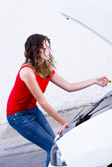 woman checking oil motor level in her car