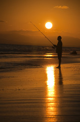 Fisherman at sunset, Oman