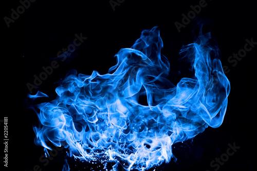 Leinwandbild Motiv blue fire on black background