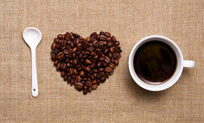 Coffee beans heart, cup  on hessian. I Love Coffee concept