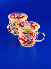 Tea cups on a blue background
