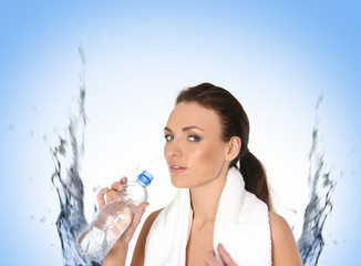 A young and sporty female drinking water