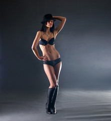 Sexy woman in erotic lingerie posing on a dark background