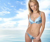 A young and sexy blond in light-blue erotic lingerie poster