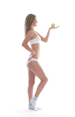 A young and sexy blond holding an apple