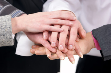 Image of different people shaking their hands together