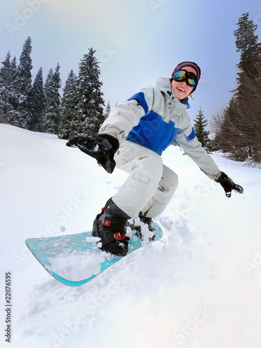 Snowboarder Girl riding down