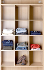 Clothes in wardrobe on the shelves