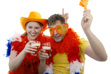 Two Dutch soccer fans in orange outfit over white background