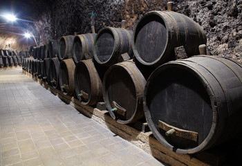 barrel with wine in cellar