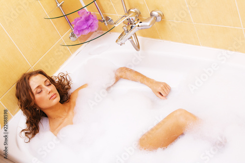 Young woman relaxing in a bath