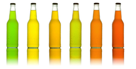 Line of different color glass bottles with beverage