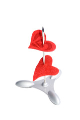 Two red hearts on a paper spike (isolated on white)