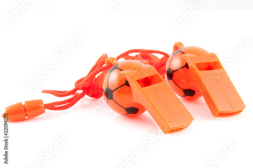 Two orange soccer whistles