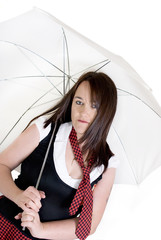 woman dressed up as a schoolgirl holding a parasol.