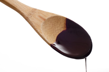 Melted dark chocolate on wooden spoon