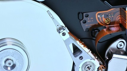 Close up of a hard disk plate and reader head.