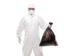 A man in uniform holding a black garbage bag isolated on white