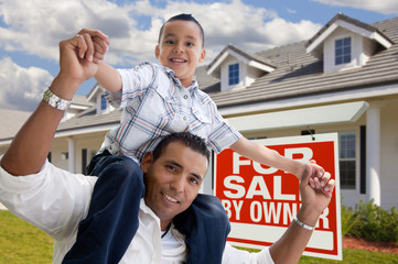 Hispanic Father and Son with For Sale By Owner Sign