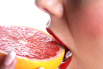 Young Woman Eating Grapefruit.Model Released