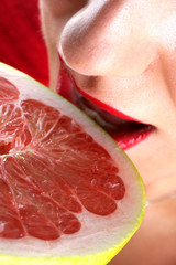 Young Woman Eating a Sliced Pomelo.Model Released