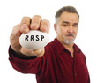 Mature man holds an egg with RRSP on it.