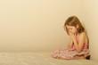 Sad girl praying