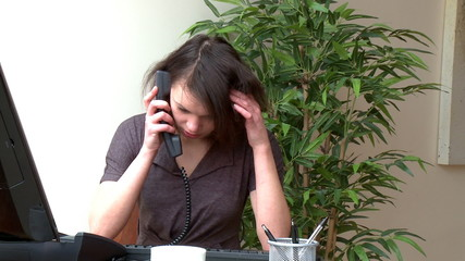 Irritate woman talking on phone at home