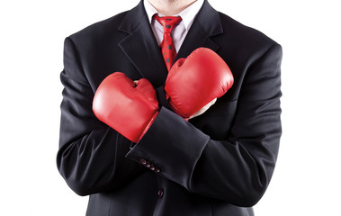 Businessman with attitude wearing boxing gloves