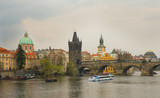 View of Prague with Charles bridge at overcast day poster