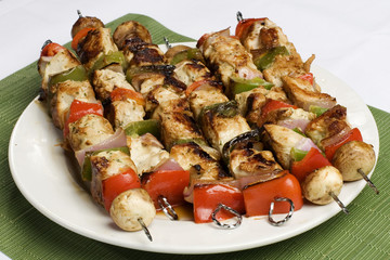 Barbequed kebabs on white plate
