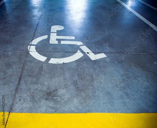 Disability sign in parking garage, underground interior - 22132176