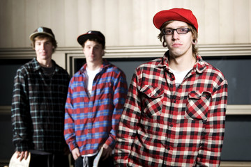 Three skateboarders standing together