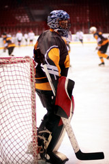 Hockey goalkeeper in generic black equipment