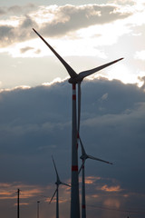 wind turbine with clouds in background