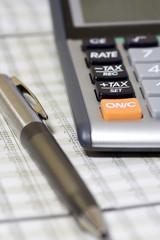 Balancing the Accounts. Calculator, pen
