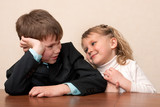 Schoolchildren communicating at the class desk poster