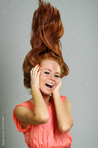 Portrait of sexy young woman isolated on grey background