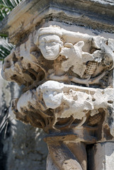 Detail of an ancient column, exterior of a Sicilian church