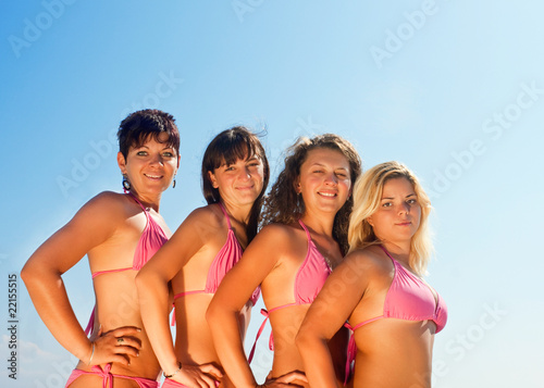 group of happy girls in bikinis