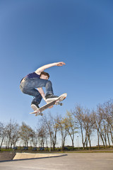 boy with skate board is going airborne