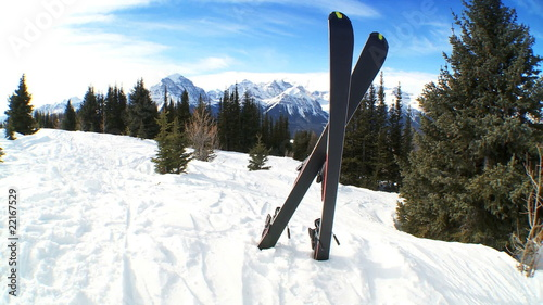 Crossed carver downhill skis in fresh clean snow