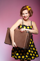 pin-up girl with luggage