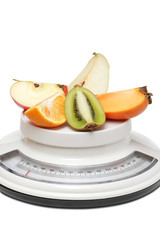 Fruits on kitchen scales