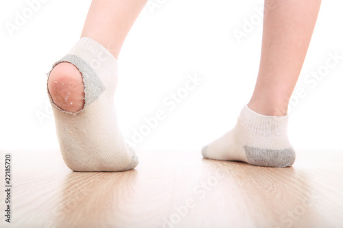 Boy wearing dirty socks with holes in them